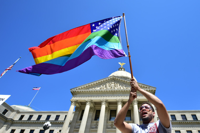 Meridian resident Nykolas Alford waves a rainbow-colored flag designed with the U.S. flag during a Human Rights Campaign protest of House Bill 1523 on the Mississippi State Capitol steps in Jackson, Miss., on  March 29.