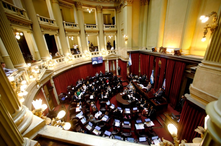 Senators debate the approval of a settlement with creditors over the country's defaulted debt at the Senate in Buenos Aires