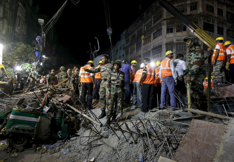 Image: Firefighters and rescue workers search for victims at the site of an under-construction flyover after it collapsed in Kolkata