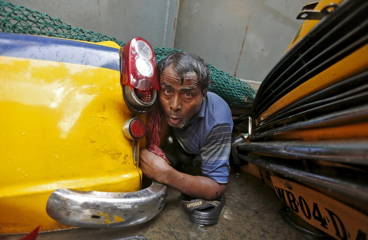 Image: A man is seen trapped amid the debris of an under-construction flyover after it collapsed in Kolkata