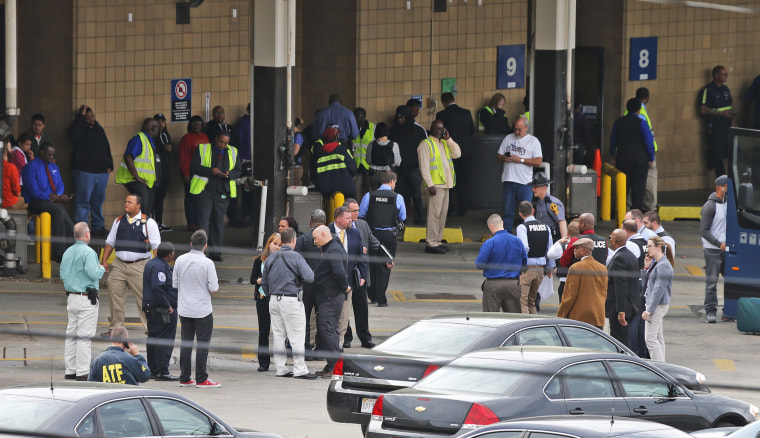 Image: Police and rescue officials gather outside the Greyhound Bus Station
