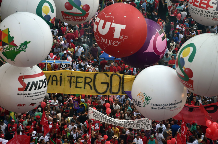 Image: Unionists and Worker's Party (PT) supporters demonstrate in Sao Paulo