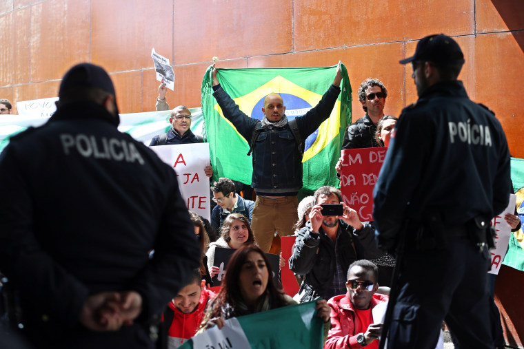 Image: Supporters of President Dilma Rousseff protest outside the Lisbon University