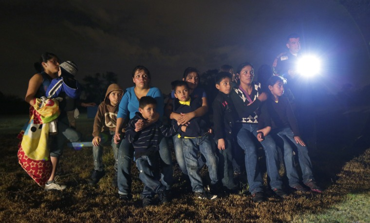 A group of immigrants from Honduras and El Salvador who crossed the U.S.-Mexico border illegally are stopped in Granjeno, Texas on June 25, 2014. The epicenter of the 2014 surge in illegal immigration is a 5-mile slice of deep South Texas that has become a hot spot for migrants, human smugglers and drug cartels.