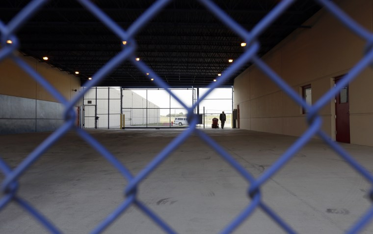 A secured entryway is seen at the Karnes County Residential Center in Karnes City, Texas on July 31, 2014. Federal officials gave a tour of the South Texas immigration detention facility that has been retooled to house adults with children who have been apprehended at the border.