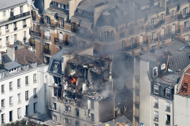 Image:  Flames erupt from an apartment building following an explosion that occured in Paris