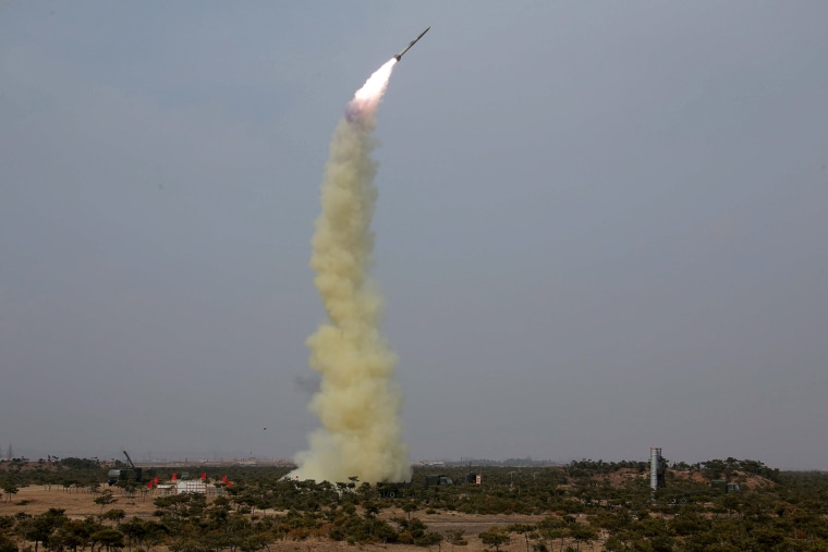 Image: A new type of anti-air guided weapon system is fired by North Korea