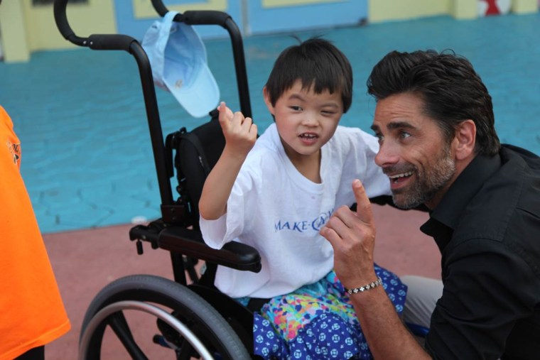 """John Stamos bonds with Faith, a 6-year-old girl who is """"usually shy around strangers but she instantly connected with John Stamos and was eager to interact with him,"""" according to her father, Shannon Keith Ginn."""