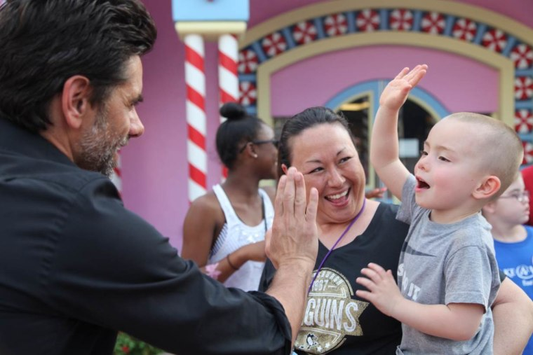 According to Pamela Landwirth, president of Give Kids The World, actor John Stamos has been donating his time to the charity for 15 years.