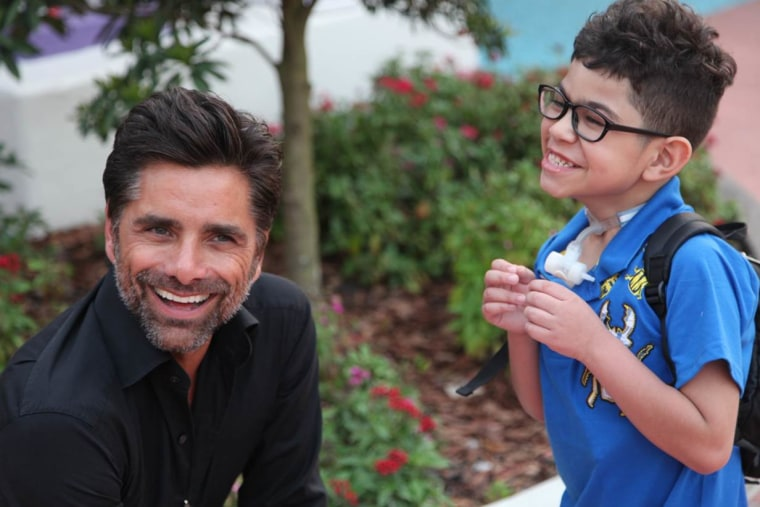 """""""He's a very wonderful person,"""" Pamela Landwirth, president of Give Kids The World, said of actor John Stamos. """"He's very authentic, very down-to-earth."""""""