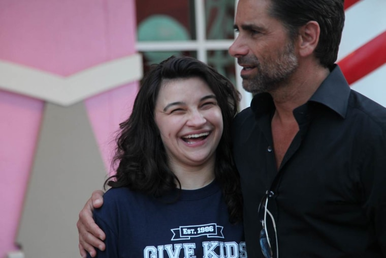 """Pamela Landwirth, president of Give Kids The World, praises John Stamos for volunteering his time at the resort where the charity provides vacations to families of children with serious illnesses: """"He's all about the kids and the families."""""""