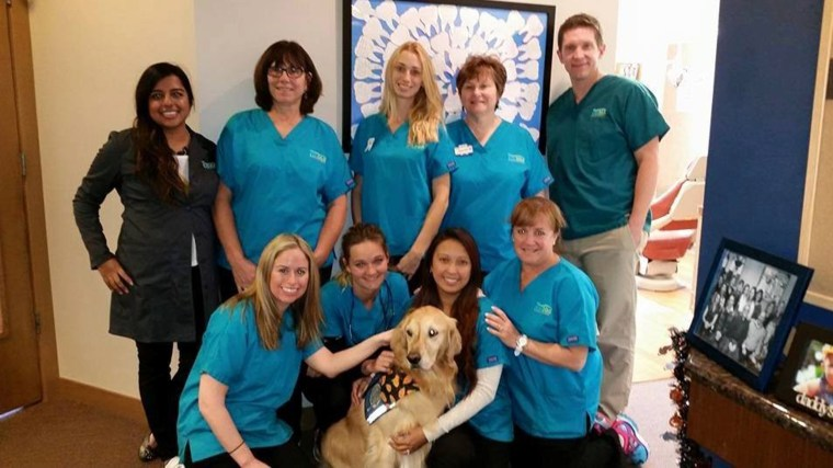 The office of Pediatric Dentistry of Northbrook poses with JoJo