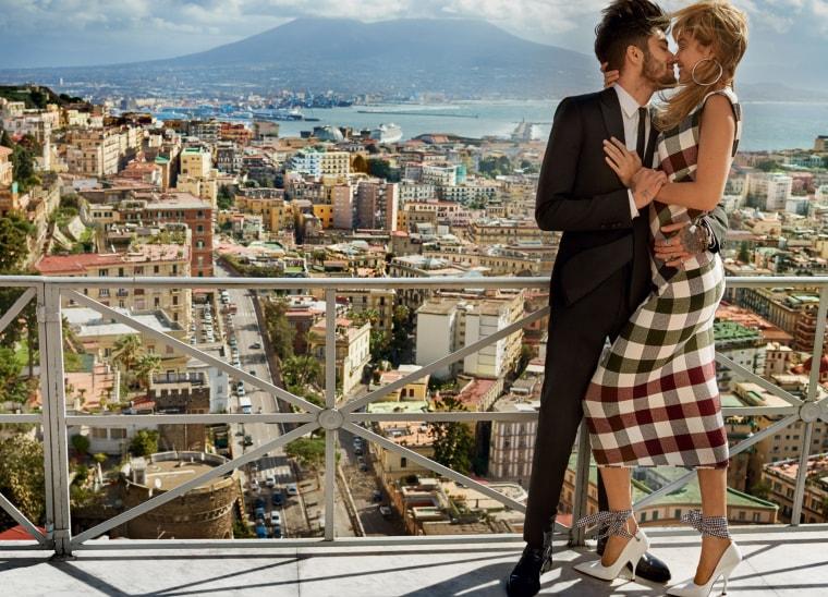 Gigi: Victoria Beckham dress, Jennifer Fisher earrings, Miu Miu shoes // Zayn: Saint Laurent suit, Jimmy Choo shoes