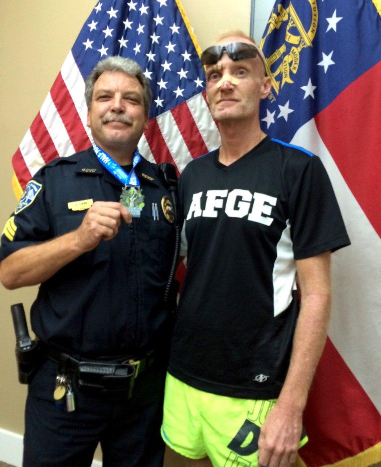 officer-helps-marathon-runner-inline-today-160405