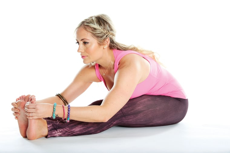 Kathryn Budig demonstrates yoga poses from her new book