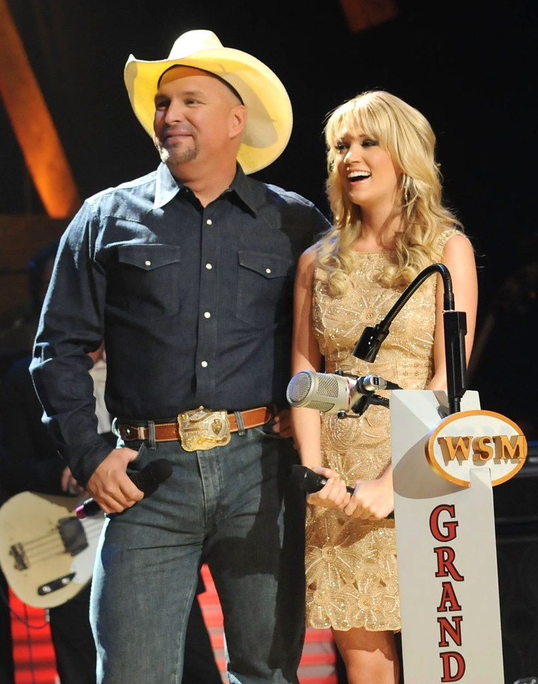 Carrie Underwood inducted the newest member of The Grand Ole Opry by fellow Opry member Garth Brooks