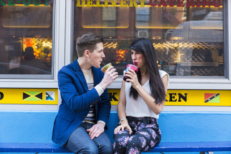 Alex Ficquette and am New York's Melissa Kravitz grab a juice at Melvin's Juice Box in the West Village.