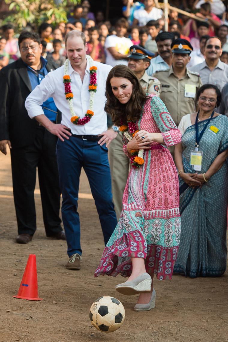 The Duke and Duchess of Cambridge kick around a football during their trip to Mumbai.