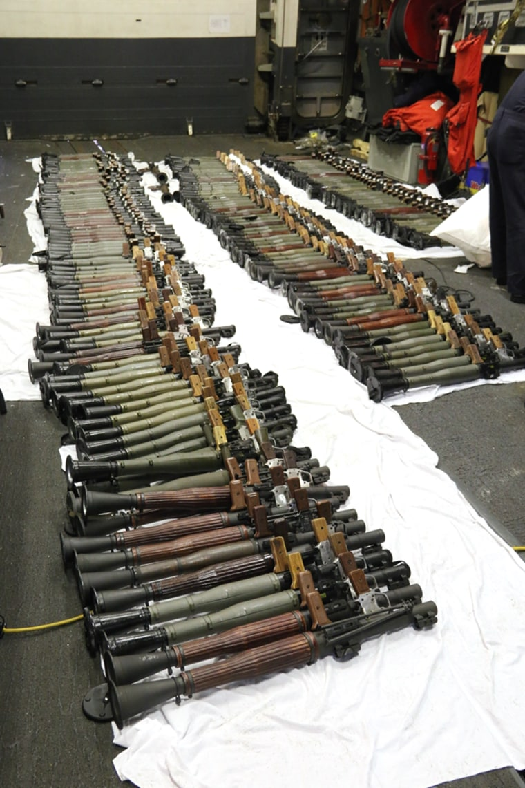 Image: A cache of weapons is assembled on the deck of the guided-missile destroyer USS Gravely