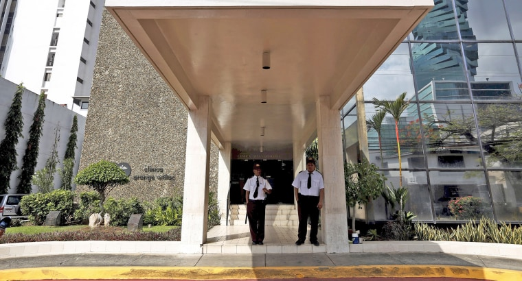Image: Security guards are seen outside the Arango Orillac Building where the Mossack Fonseca law firm is situated at, in Panama City