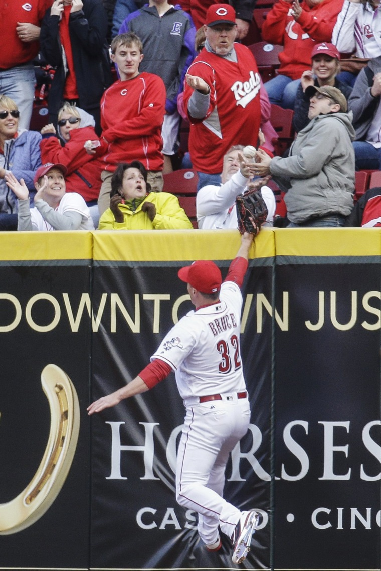 Image: Cincinnati Reds right fielder Jay Bruce reaches for but misses a two-run home run