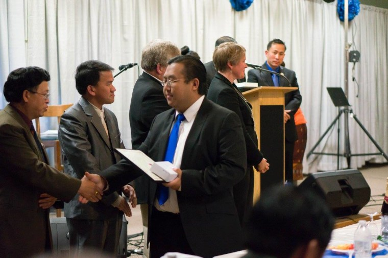 Yee Leng Xiong at a Hmong community leader congratulation party in Wausau, Wisconsin.