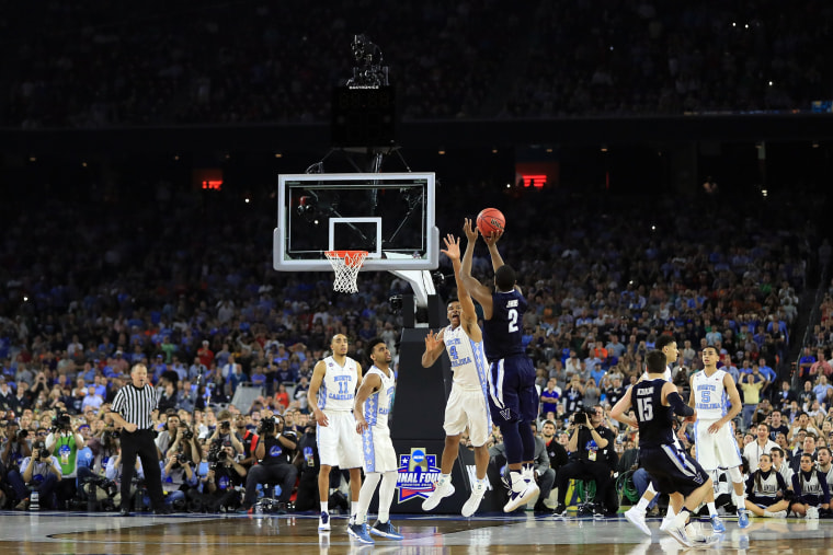 Image: Kris Jenkins no.2 of the Wildcats shoots the game-winning three pointer to defeat the Tar Heels 77-74