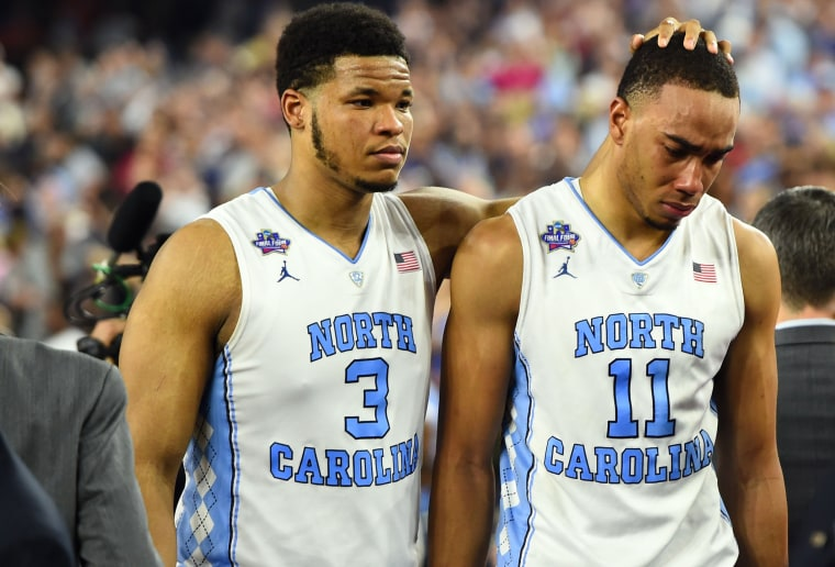 Image: Tar Heels forward Kennedy Meeks no.3 and forward Brice Johnson no.11 react after the game