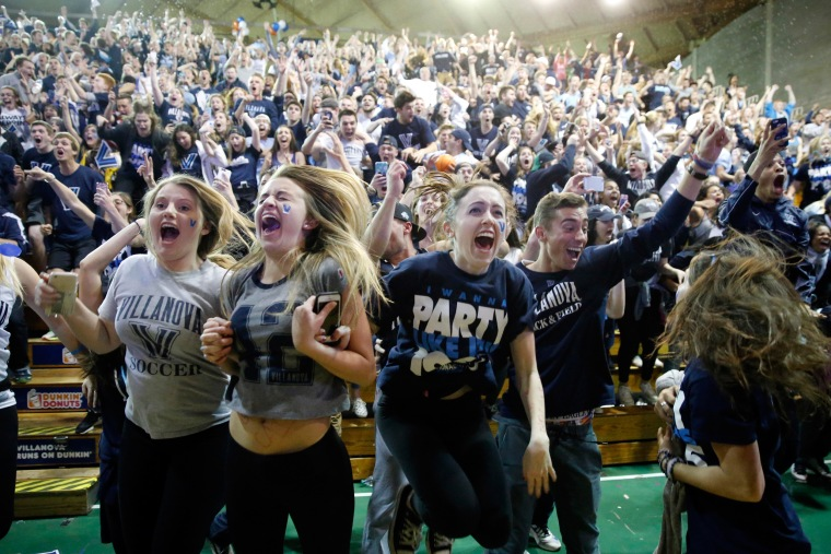Image: Wildcats basketball fans celebrate their team's win