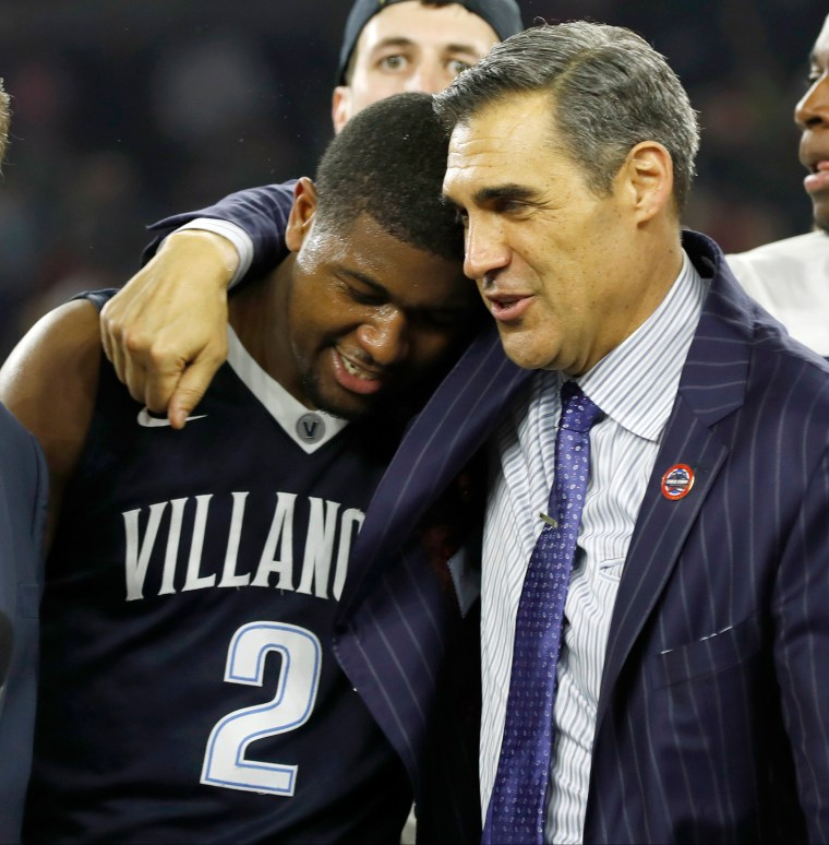Image: Villanova head coach Jay Wright, right, embraces Kris Jenkins after Jenkins scored a game winning three point basket in the closing seconds of the game