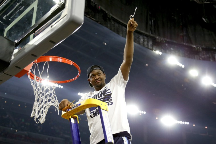 Image: Kris Jenkins no.2 of the Wildcats cuts the net after defeating the Tar Heels
