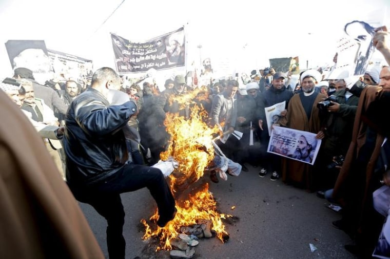 Supporters of Shi'ite cleric Moqtada al-Sadr burn an effigy of King Salman of Saudi Arabia during a demonstration against the execution of Shi'ite Muslim cleric Nimr al-Nimr in Saudi Arabia, in Baghdad, Iraq
