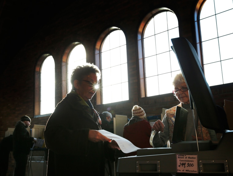 Image: A Wisconsin voter casts her ballot in the state's primary at the South Shore Park Pavilion in Milwaukee