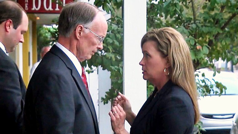 Alabama Governor Robert Bentley speaks with former aide Rebekah Mason.