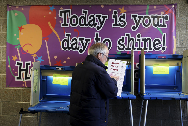 Image: A voter casts his ballot in the Wisconsin presidential primary election at a voting station in Milwaukee