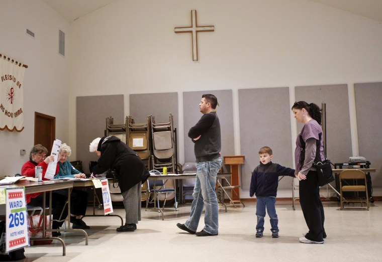 Image: Voters wait in line to casts their ballots at the Divine Peace Lutheran Church during voting for the Wisconsin U.S. presidential primary election in Milwaukee