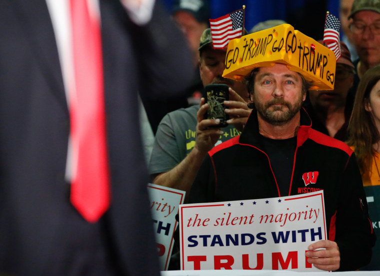 Image: A supporter listens to U.S. Republican presidential candidate Donald Trump in La Crosse