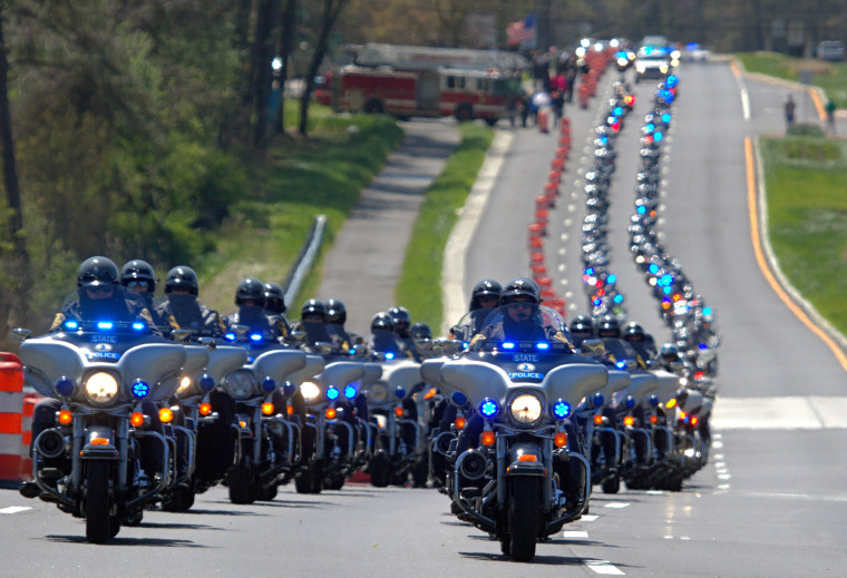 Image: Motorcycles lead a procession for Virginia Trooper Chad P. Dermyer in York Co.