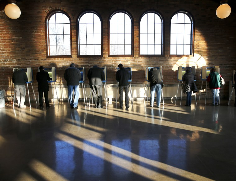 Image: Wisconsin voters cast their ballots in the state's primary at the South Shore Park Pavilion