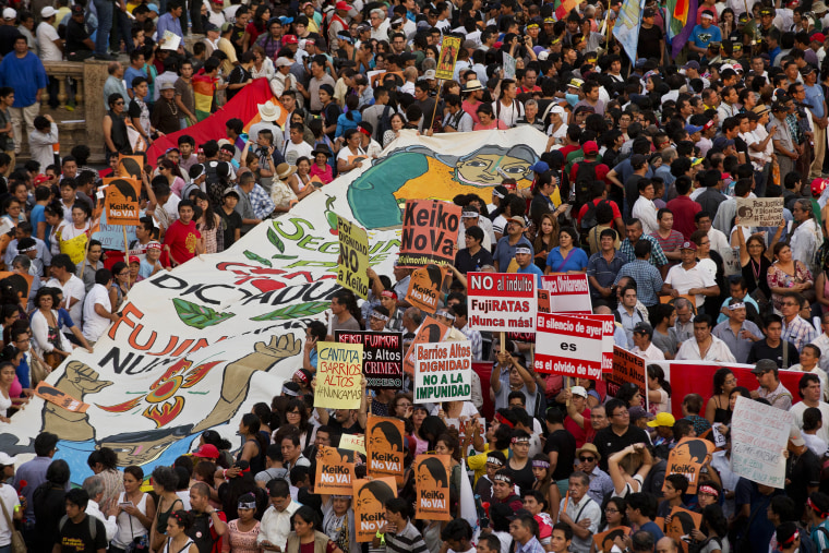 Image: Demonstrators take part in a protest against presidential candidate Keiko Fujimori