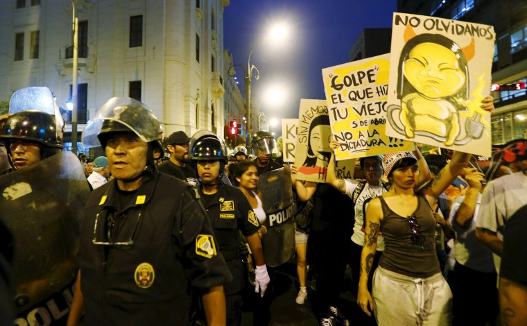 Image: Police stand guard as protesters march against Peruvian presidential candidate Keiko Fujimori in downtown Lima