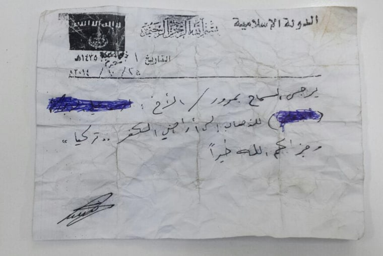 ISIS document provided to a smuggler identified as Abu Mustafa allowing him to travel freely from Raqqa, Syria to Southern Turkey.