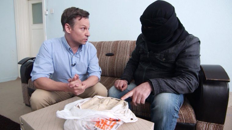 An ISIS smuggler identified as Abu Mustafa shows NBC News Chief Foreign Correspondent Richard Engel a relief statue he claims is a Palmyrene antiquity.