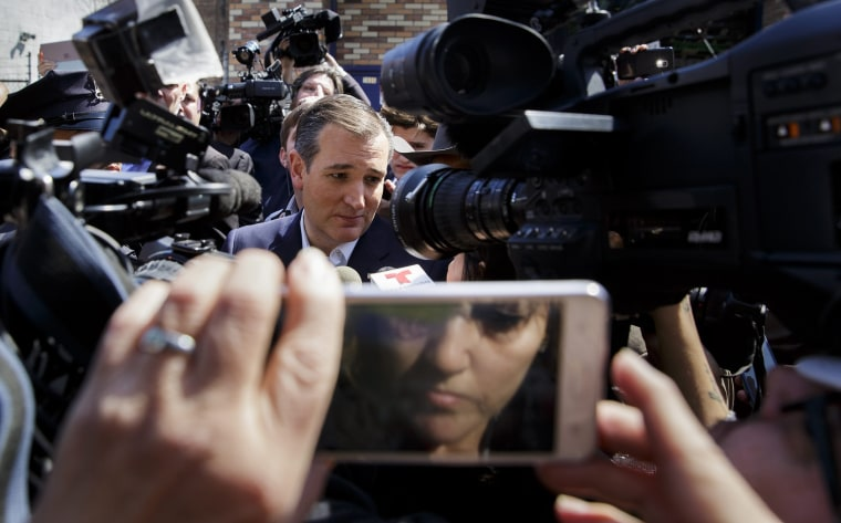 Image: Cruz talks to reporters after an election campaign event