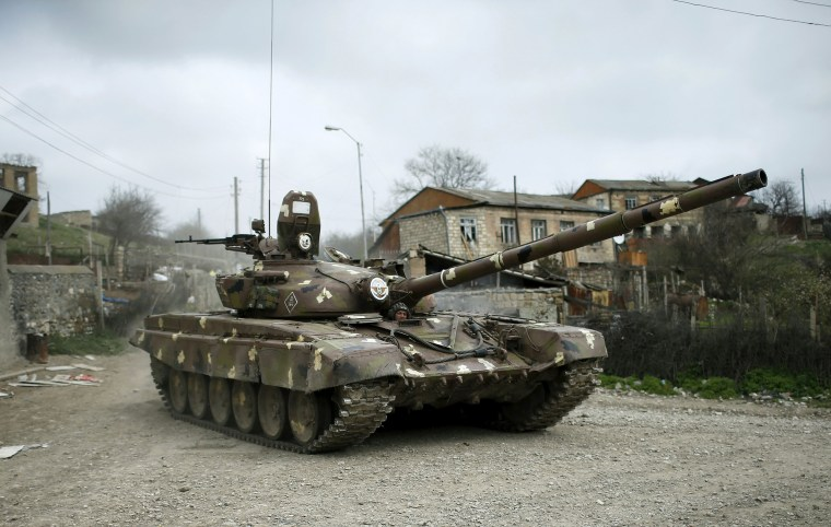 Image: A tank belonging to the self-defense army Nagorno-Karabakh heads down the road
