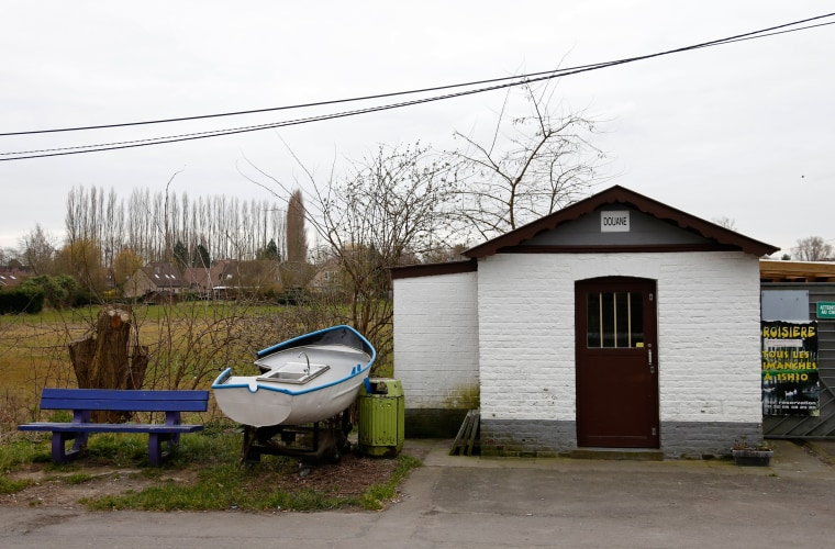 Image: A old customs post along a river at the border between Belgium and France in Leers-Nord