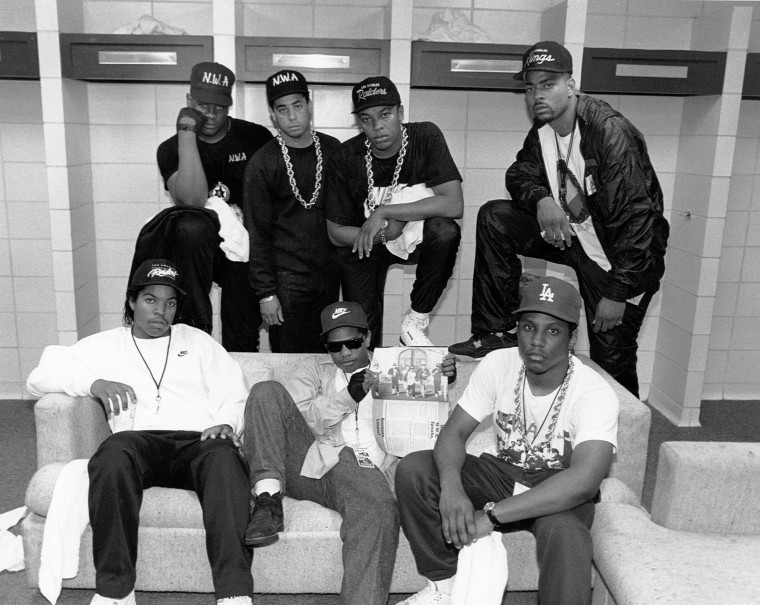 Rap group N.W.A. pose with rappers The D.O.C. and Laylaw from Above The Law (L-R standing: Laylaw, DJ Yella, Dr. Dre and The D.O.C. seated Ice Cube, Eazy-E and MC Ren) backstage at the Kemper Arena during their 'Straight Outta Compton' tour in June 1989 in Kansas City, Missouri.