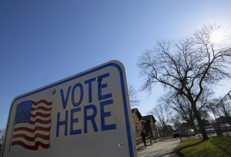 Image: A voter arrives to cast their ballot in the Wisconsin presidential primary election at a voting station in Milwaukee