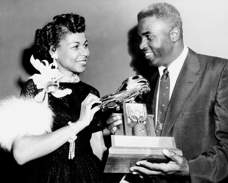 Brooklyn Dodgers' Jackie Robinson and his wife, Rachel, admire the golden shoe he received from leaders of the shoe industry at their dinner at the Hotel Roosevelt. The dinner was to raise funds for the United Jewish Appeal. Robinson was honored as 'Athlete of the Year' at the affair at which $600,000 was pledged to the UJA drive.