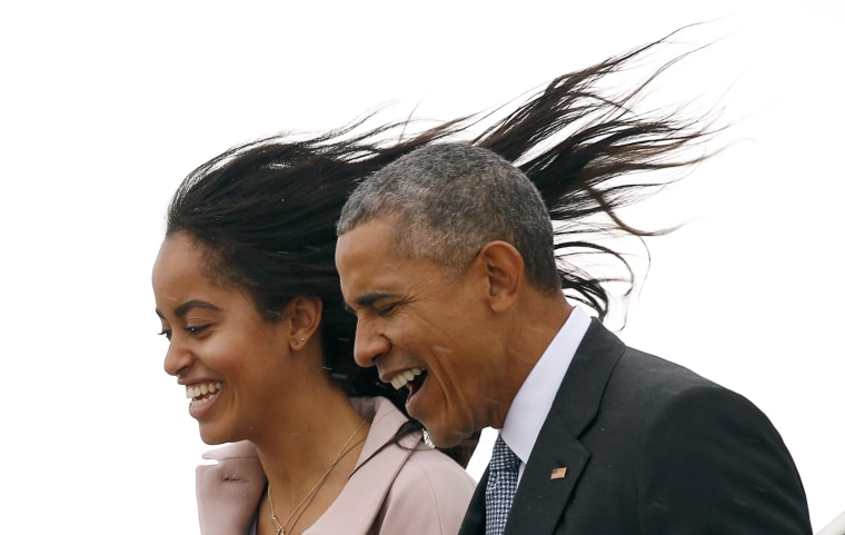 Image: Malia Obama's hair flies into the air as a cold wind hits her and U.S. President Barack Obama